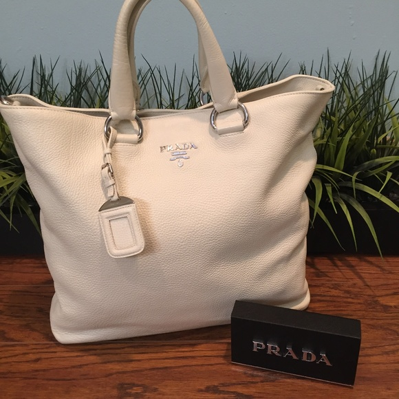 bd6a0dfa0e Authentic Prada Leather Tote in Cream dcb1058. M_5b3584d7c89e1d82ccaa17a2